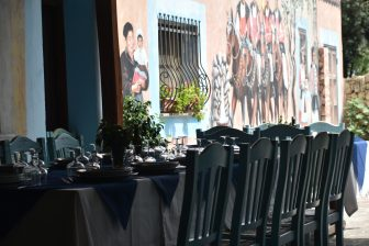 Italy-Sardinia-Alghero-agriturismo-Barbagia-table-chairs-painted wall