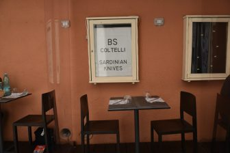 Italy-Sardinia-Alghero-restaurant-Trattoria da Mirko-table-chairs-plastic sheets