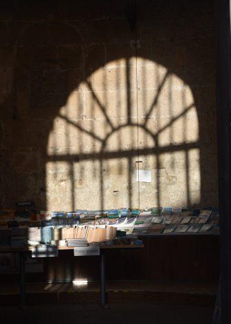 Italy-Sardinia-Alghero-Torre di Porta Terra-book fair-shadow
