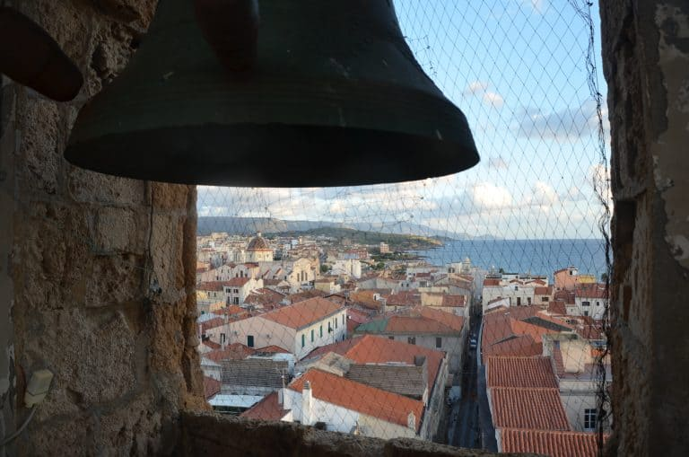 going up the bell tower of Alghero's cathedral and then eat Pintxos