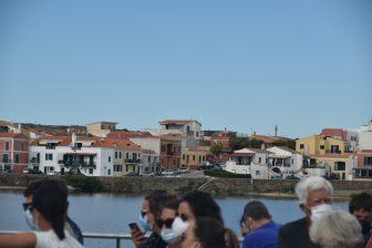 Italy-Sardinia-Stintino-people on board-houses