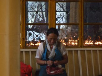 India, Dharamsala – woman and candles, Sept.2006