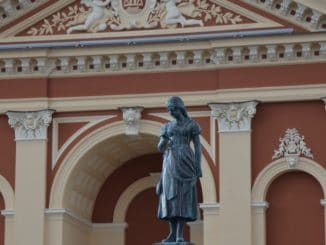Lithuania, Klaipeda – statue of girl and theatre, Sept.2014
