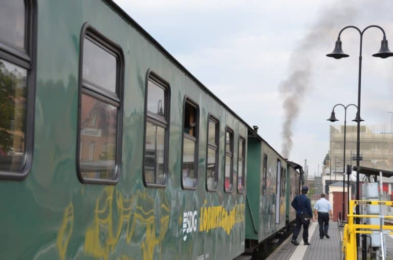 Slow journey by locomotive train and carriage