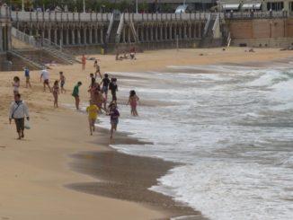 Spain, San Sebastian – people on beach, May 2014