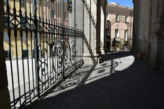 Italy-Sardinia-Sassari-cathedral-gate-shadow