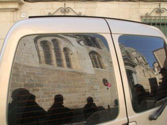 Spain, Toledo – reflection on car, Mar. 2014