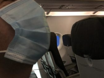 England-in the air-in the aeroplane-surgical mask-seat-empty