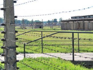 Poland, Birkenau – barbed wire and wooden hut, May 2009