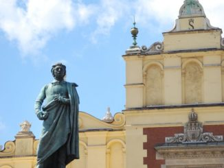 Poland, Krakow – statue and building, May 2009