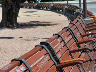 Spain, Madrid – rows of benches, July 2012