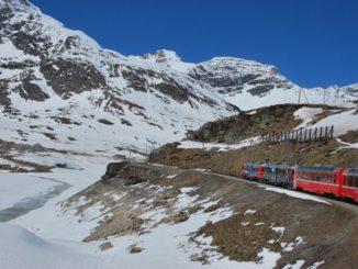 Switzerland, Bernina Express – train in a snowy view, May 2012