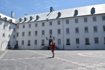 Canada-Quebec City-seminary-white building-a person taking photos
