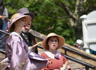 Canada-Prince Edward Island-Charlottetown-people in costume-singing