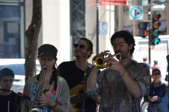 Canada-Montreal-Place d'Armes-young people-playing-jazz
