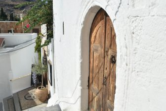 Greece-Rhodes-Lindos-white house-wooden door