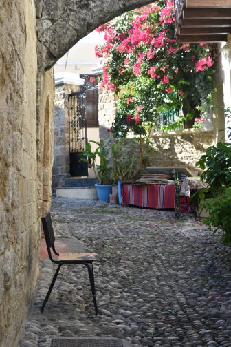 Greece-Rhodes-Rhodes Town-old town-cobbled street-flowers-chair