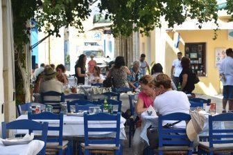 Greece-Symi Island-old town-restaurant-Taverna Meraklis-tables-chairs-people