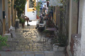 Greece-Symi Island-Symi old town-slope-person-sitting