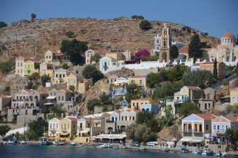 Greece-Symi Island-Gialos-old town-colourful houses-hill