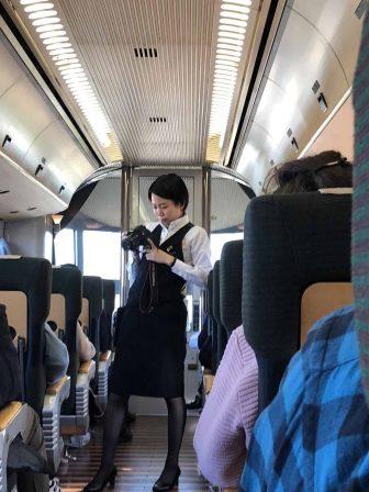 "Japan-Kyushu-Oita-limited express train-""Yufuin no Mori""-inside-woman-taking photos"