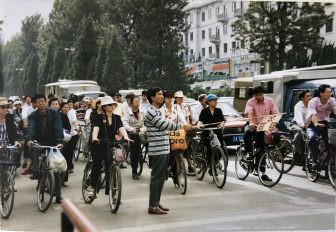 China-Kunming-city centre-many cyclists-traffic control