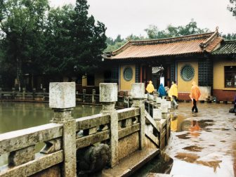 China-Kunming-city tour-Gailong Palace-rain-people