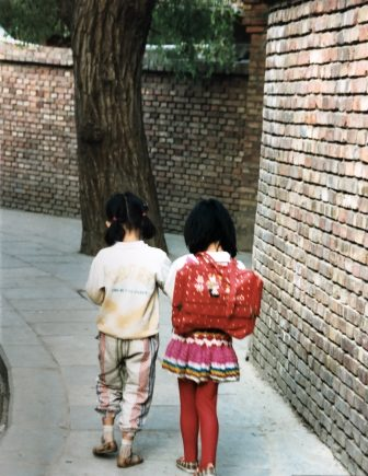 China-Lanzhou-two girls-brick wall