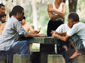 China-Yangshuo-Yasngshuo Park-men-playing cards