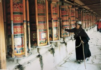 China-Xiahe-prayer wheels-woman-costume