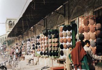 China-Kashgar-bazaar-hat shops-woman-brown scarf