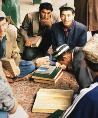 China-Kashgar-Id Kah Mosque-young men-reading Koran