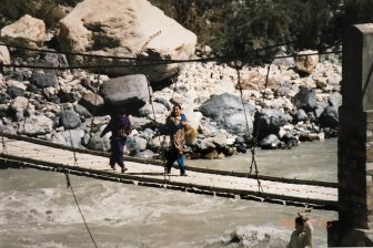 Pakistan-from Sust to Karimabad-Karakorum Highway-people-crossing-suspension bridge-river