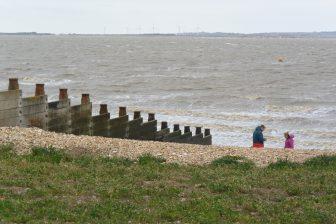 England-Whitstable-sea-groyne-people