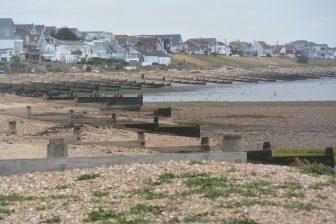 England-Whitstable-beach-view-houses-groynes-sea