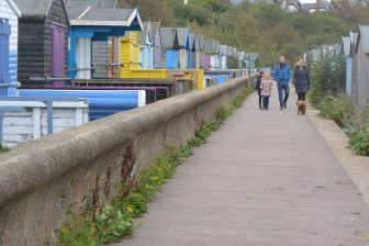 England-Whitstable-beach huts-road-people