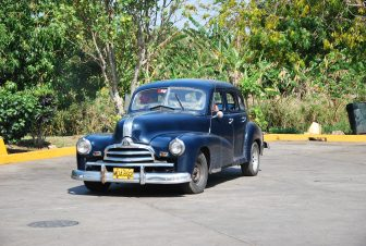 A classic car parked at a petrol station in Cuba