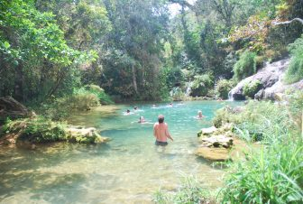 tourists bathing in the basin of the waterfall in Topes de Collantes, Cuba