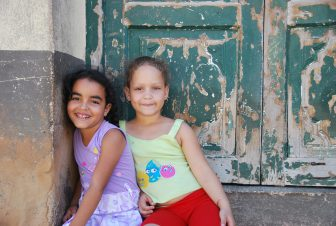 two young girls near the market in Trinidad in Cuba