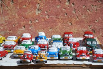 the colourful classic car toys soled at a street market in Trinidad in Cuba