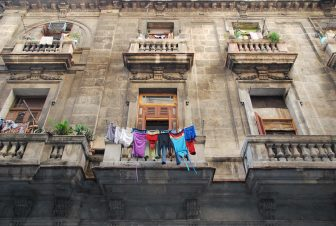 a building with windows and the laundry in Havana in Cuba