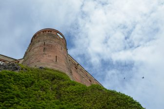 looking up at Bamburgh Castle in Northumberland