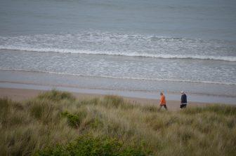 people walking along the coast of Northumberland