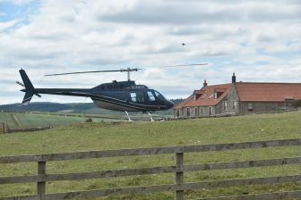 a helicopter parked outside of the restaurant in Northumberland
