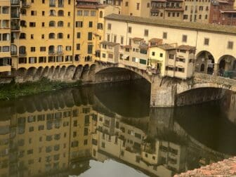 the view of Ponte Vecchio and its reflection from the room